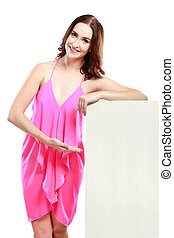 beautiful woman with hand lean on white board while presenting it