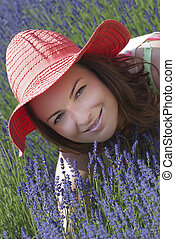Beautiful woman with hat in a lavender field
