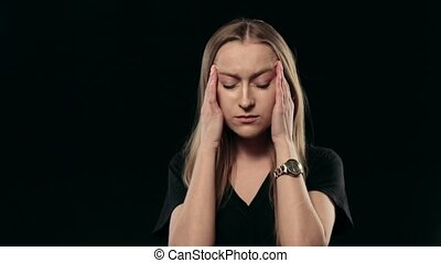 Beautiful woman with headache touching her temples