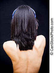 Beautiful woman with headphones on black background