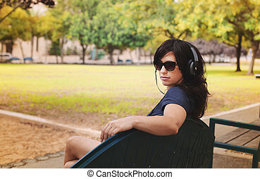Beautiful Woman with Headphones Outdoors