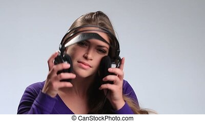 Beautiful woman with headset listening music