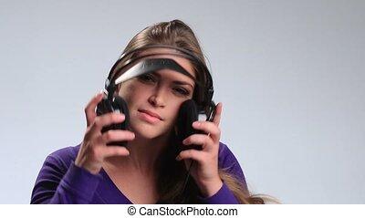 Beautiful woman with headset listening music