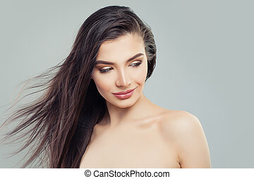 Beautiful woman with healthy skin and long perfect hair on white background