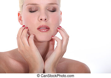 Beautiful woman with her eyes closed