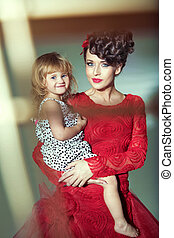Beautiful woman with her joyful daughter