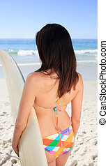 Beautiful woman with her surfboard