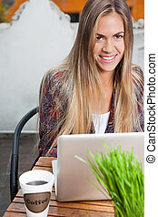 Beautiful Woman With Laptop At Cafe