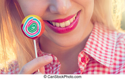 Beautiful woman with lollipop