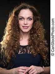 Beautiful woman with long brown curly hair