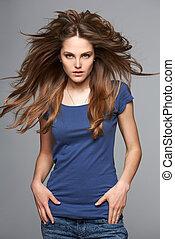 Beautiful woman with long brown hair - Fashion model posing...