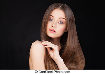 Beautiful Woman with Long Brown Hair on Black Background
