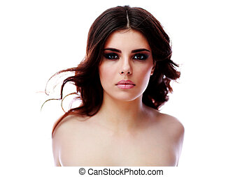 Beautiful woman with long brown hair. Closeup portrait of a fashion model posing at studio