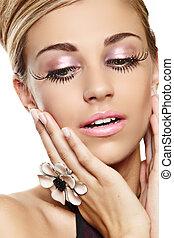 beautiful woman with long eyelashes.