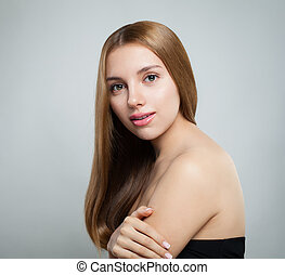 Beautiful woman with long healthy brown hair and fresh skin. Cosmetology, beauty, haircare and spa portrait