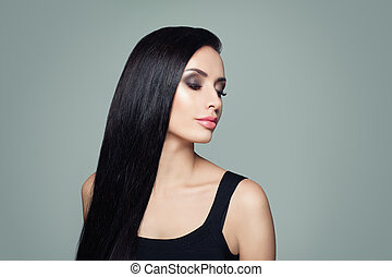 Beautiful woman with long healthy straight hair and makeup portrait