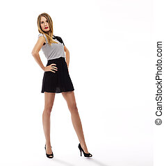 beautiful woman with long legs and a mini skirt on white background