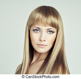 Beautiful woman with long smooth healthy blonde hair