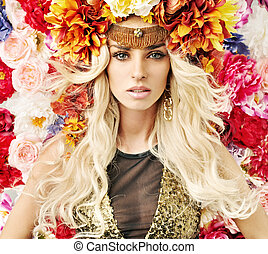 Beautiful woman with lots of colorful flowers