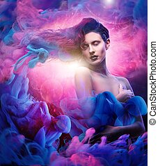 Beautiful woman with magnificent galaxy hair in blue, pink...