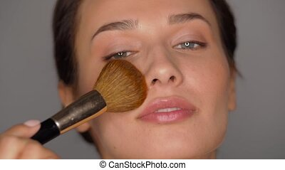 beautiful woman with makeup brush - beauty and cosmetics ...