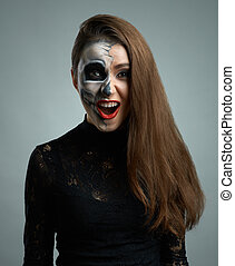beautiful woman with makeup skeleton dumbfounded - beautiful...
