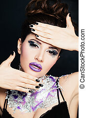 Beautiful Woman with Manicure Nails and Creative Makeup