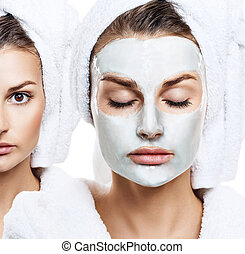 Beautiful woman with mask on her face.