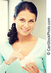 beautiful woman with moisturizing creme - picture of...