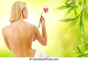 Beautiful woman with naked back over green abstract background