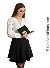 Beautiful woman with notebook on white background