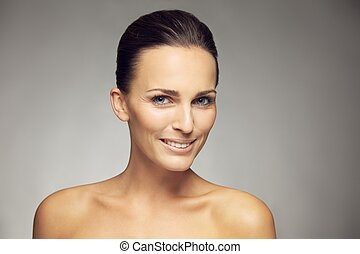 Beautiful woman with perfect healthy skin