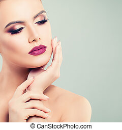 Beautiful Woman with Perfect Makeup on Background with Copy space. Beautiful Female Face Closeup