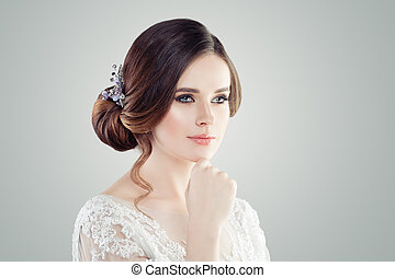 Beautiful woman with perfect updo hair and makeup