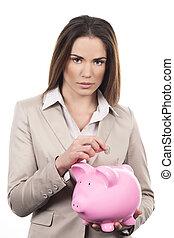 beautiful woman with piggy bank