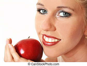 Beautiful woman with red apple isolated on the white background