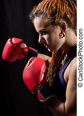 Beautiful woman with red boxing gloves, dreadlocks