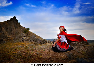 beautiful woman with red cloak outdoor