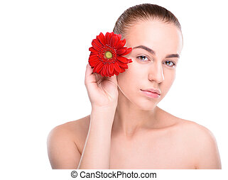 Beautiful woman with red gerbera. Isolated on white background