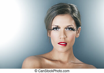 Beautiful woman with red lips and long lashes