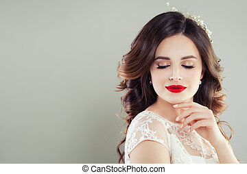 Beautiful woman with red lips makeup portrait