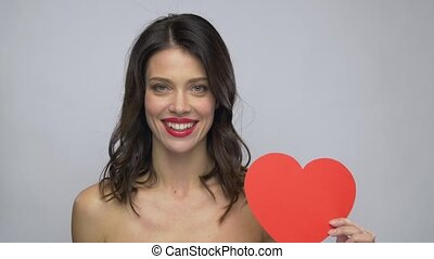 beautiful woman with red lipstick and heart shape -...