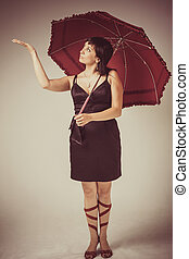 beautiful woman with red umbrella