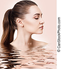 Beautiful woman with reflection on water surface