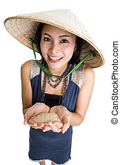 woman with rice in her hands