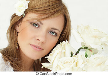 Beautiful woman with rose flowers