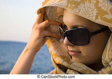 beautiful woman with scarf on sunset