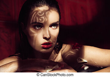 Beautiful woman with shadow of ornament