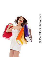 Beautiful woman with shopping bags jumping