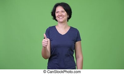 Beautiful woman with short hair giving thumbs up